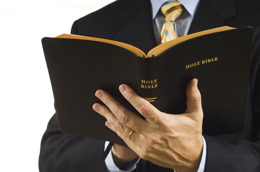 preacher holding bible open
