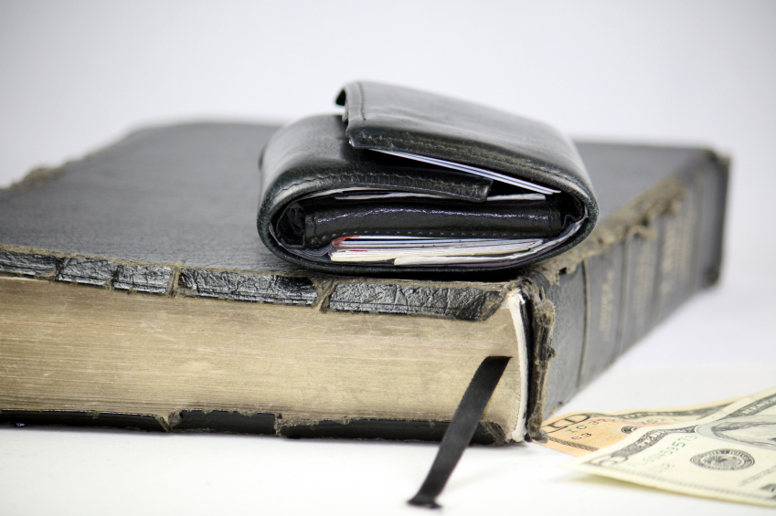 wallet sitting on bible