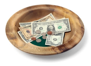 tithing plate with money