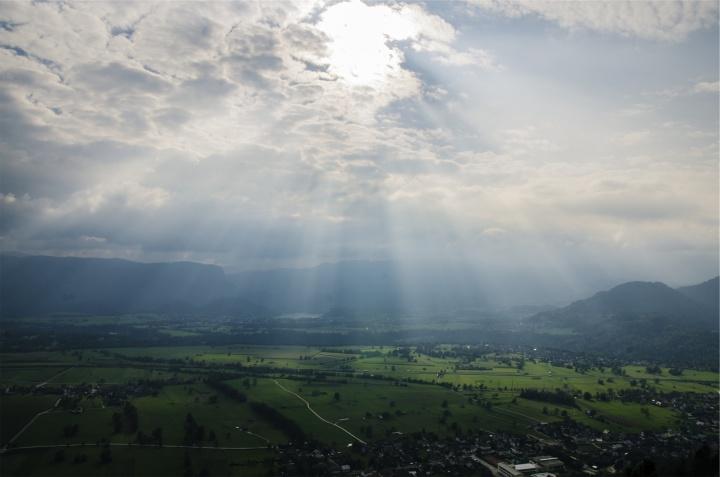 corpuscular rays over landscape